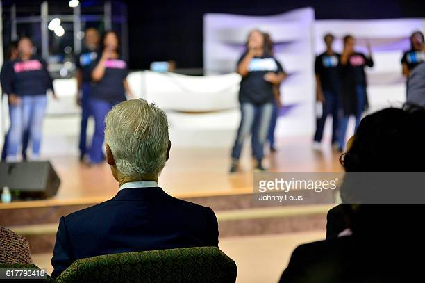 Former US President Bill Clinton sit down for church services at The Fountain of New Life Church on Sunday October 23 2016 in Miami Gardens Florida...