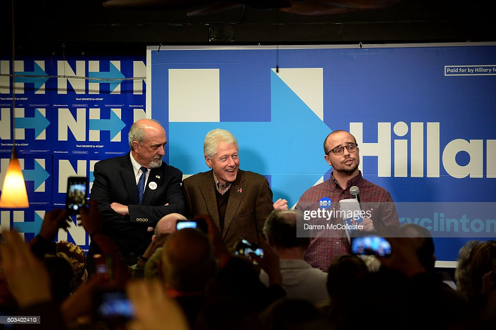 Former U.S. President Bill Clinton sits beside the former mayor of Dover, George Maglaras, (L) as he is introduced by Ben Haynes, at Hillary Clinton Dover headquarters January 4, 2016 in Dover, New Hampshire. Bill Clinton spent the day campaigning for his wife, Democratic presidential candidate Hillary Clinton.