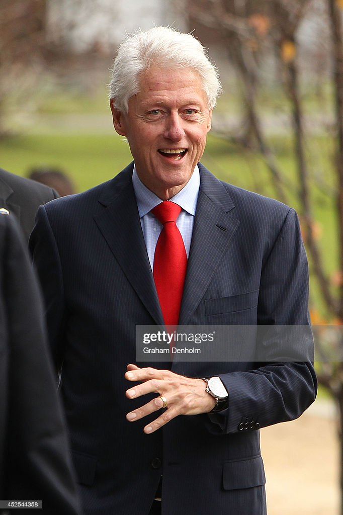 Former U.S. President Bill Clinton smiles as he leaves the 20th International AIDS Conference at The Melbourne Convention and Exhibition Centre on July 23, 2014 in Melbourne, Australia. Several researchers, activists and health workers due to attend the conference were killed enroute in the Malaysian Airlines plane MH17 shot down over Eastern Ukraine.