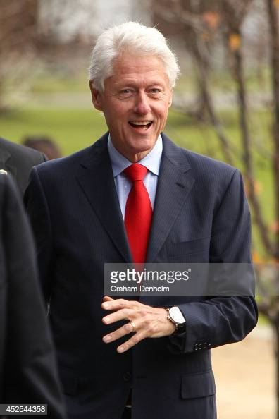 Former US President Bill Clinton smiles as he leaves the 20th International AIDS Conference at The Melbourne Convention and Exhibition Centre on July...