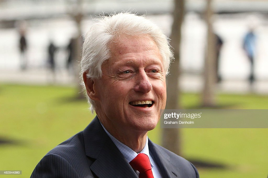 Former U.S. President <a gi-track='captionPersonalityLinkClicked' href=/galleries/search?phrase=Bill+Clinton&family=editorial&specificpeople=67203 ng-click='$event.stopPropagation()'>Bill Clinton</a> smiles as he leaves the 20th International AIDS Conference at The Melbourne Convention and Exhibition Centre on July 23, 2014 in Melbourne, Australia. Several researchers, activists and health workers due to attend the conference were killed enroute in the Malaysian Airlines plane MH17 shot down over Eastern Ukraine.