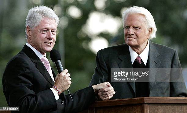 Former US President Bill Clinton speaks along with Billy Graham during Graham's Crusade at Flushing Meadows Corona Park June 25 2005 in the Queens...
