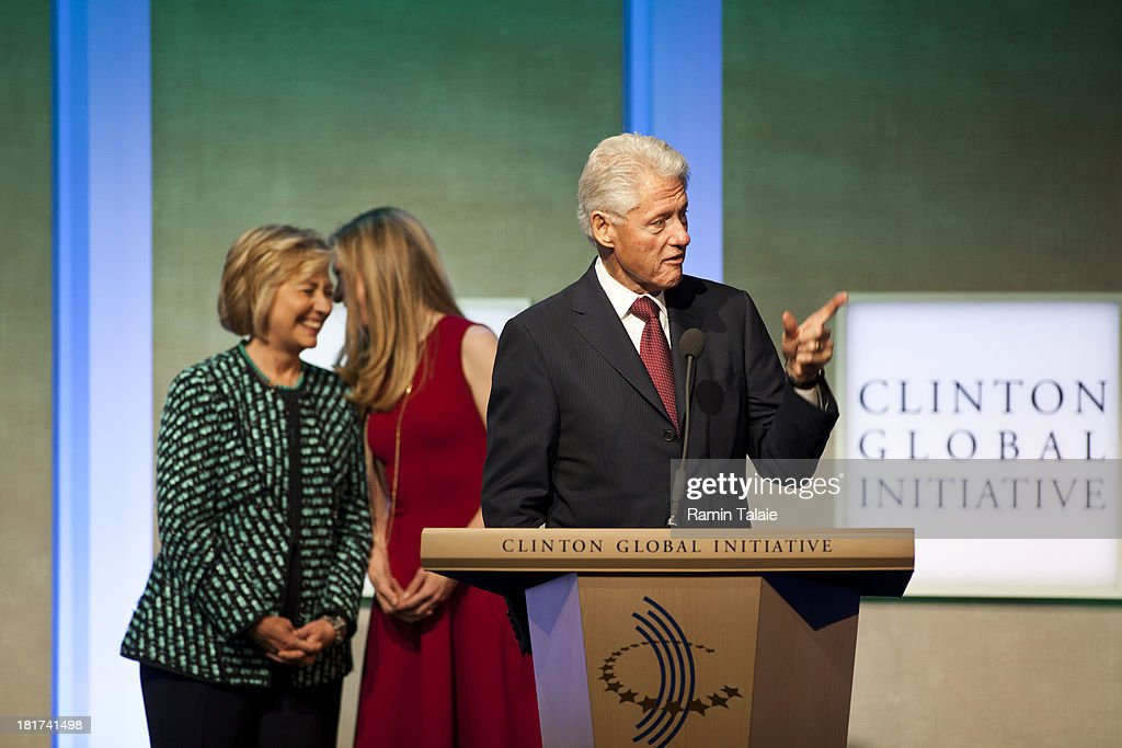 Former U.S. President <a gi-track='captionPersonalityLinkClicked' href=/galleries/search?phrase=Bill+Clinton&family=editorial&specificpeople=67203 ng-click='$event.stopPropagation()'>Bill Clinton</a> speaks as his wife <a gi-track='captionPersonalityLinkClicked' href=/galleries/search?phrase=Hillary+Clinton&family=editorial&specificpeople=76480 ng-click='$event.stopPropagation()'>Hillary Clinton</a> and daughter <a gi-track='captionPersonalityLinkClicked' href=/galleries/search?phrase=Chelsea+Clinton&family=editorial&specificpeople=119698 ng-click='$event.stopPropagation()'>Chelsea Clinton</a> speak during the Clinton Global Initiative (CGI) meeting on September 24, 2013 in New York City. Timed to coincide with the United Nations General Assembly, CGI brings together heads of state, CEOs, philanthropists and others to help find solutions to the world's major problems.