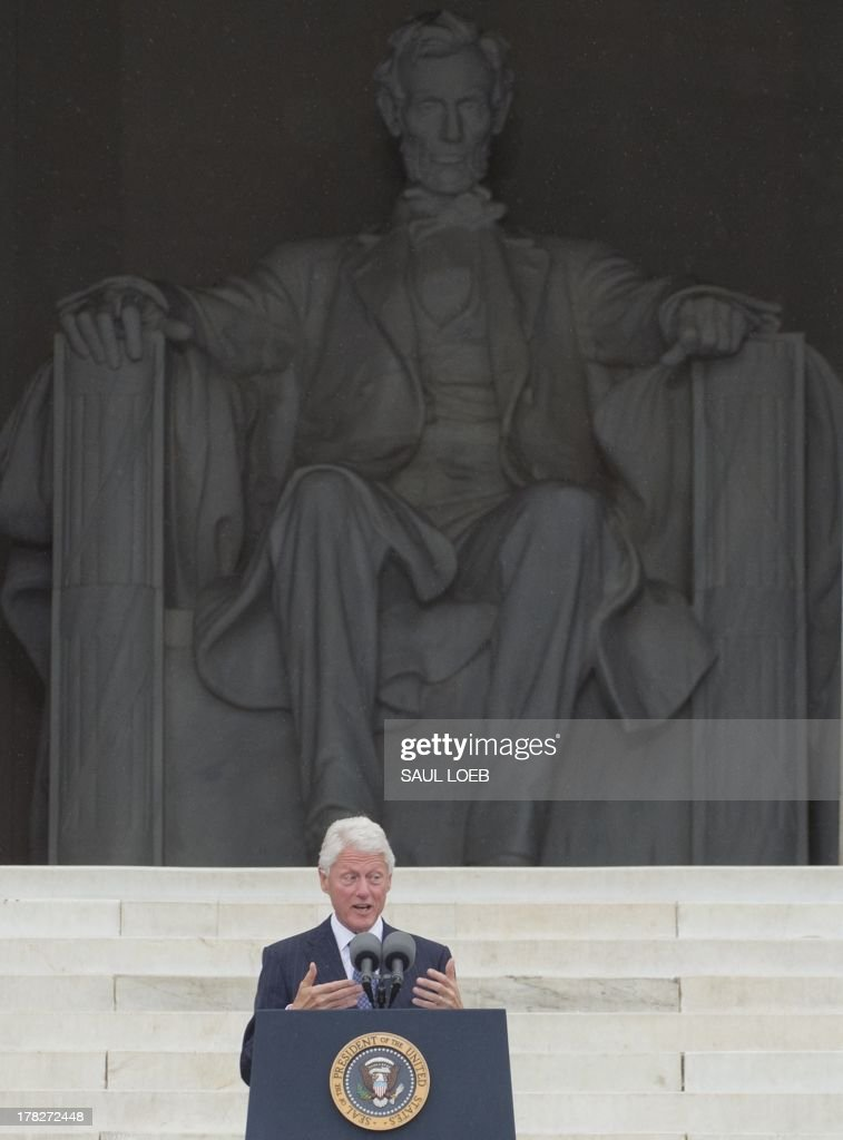 Former US President Bill Clinton speaks during the Let Freedom Ring Commemoration and Call to Action to commemorate the 50th anniversary of the March on Washington for Jobs and Freedom at the Lincoln Memorial in Washington, DC on August 28, 2013. Thousands will gather on the mall on the anniversary of the march and Dr. Martin Luther King, Jr.'s famous 'I Have a Dream' speech. AFP PHOTO / Saul LOEB