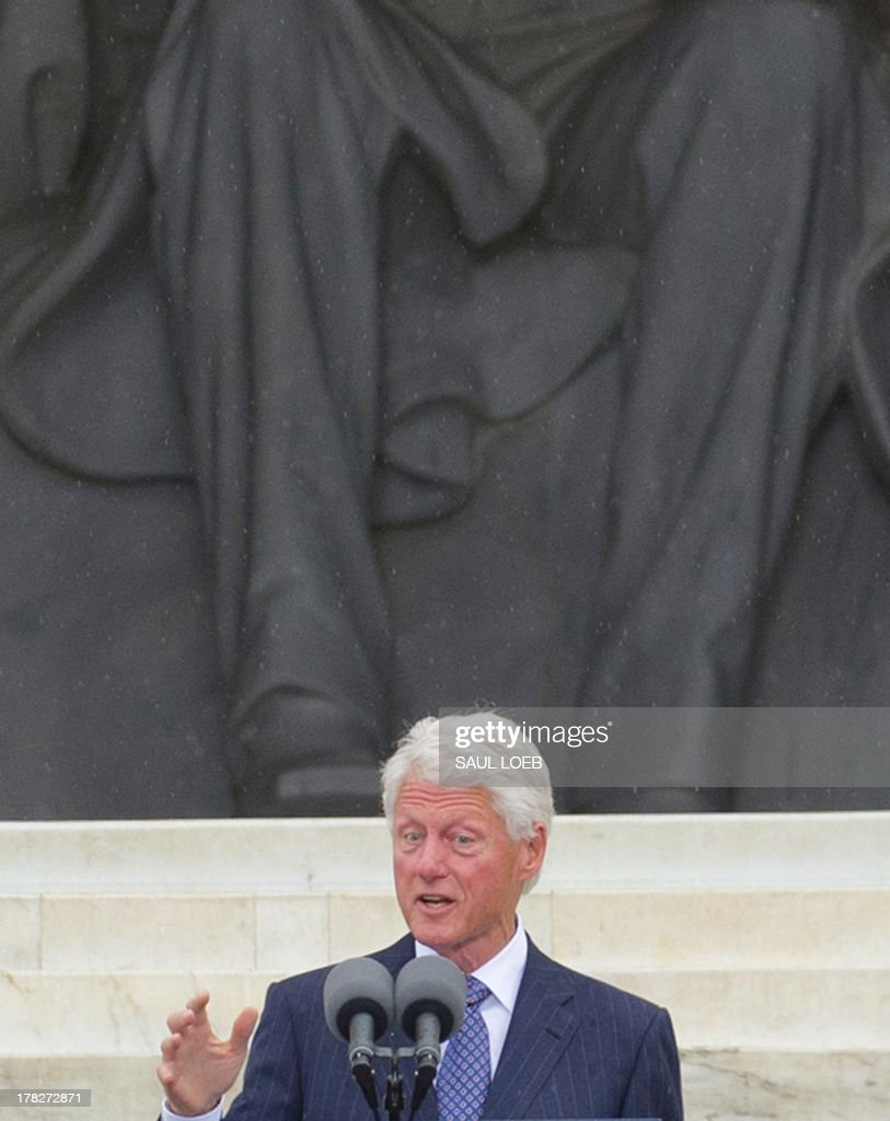 Former US President Bill Clinton speaks during the Let Freedom Ring Commemoration and Call to Action to commemorate the 50th anniversary of the March on Washington for Jobs and Freedom at the Lincoln Memorial in Washington, DC on August 28, 2013. Thousands gathered on the mall on the anniversary of the march and Dr. Martin Luther King, Jr.'s famous 'I Have a Dream' speech. AFP PHOTO / Saul LOEB