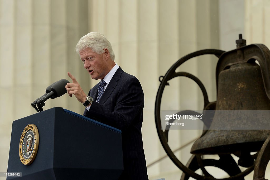 Former U.S. President Bill Clinton speaks during the Let Freedom Ring commemoration event at the Lincoln Memorial in Washington, D.C., U.S., on Wednesday, Aug. 28, 2013. U.S. President Barack Obama, speaking from the same Washington stage where Martin Luther King Jr. delivered a defining speech of the civil rights movement, said that even as the nation has been transformed, work remains in countering growing economic disparities. Photographer: Michael Reynolds/Pool via Bloomberg