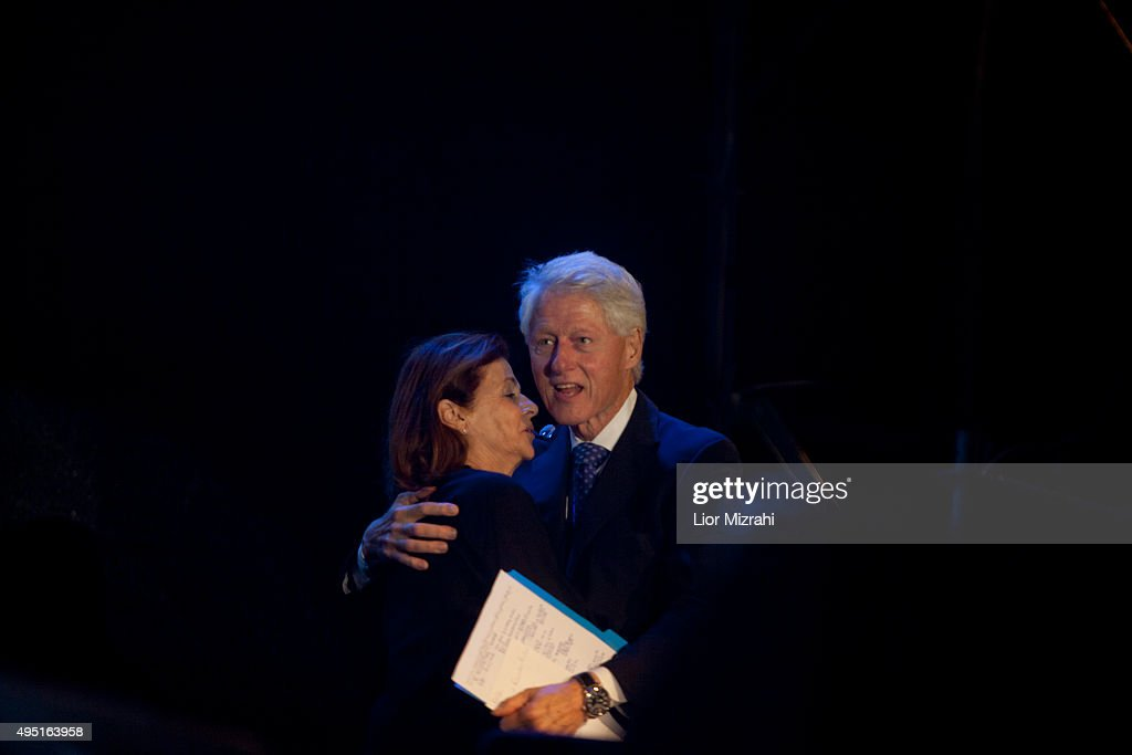 Former U.S. president <a gi-track='captionPersonalityLinkClicked' href=/galleries/search?phrase=Bill+Clinton&family=editorial&specificpeople=67203 ng-click='$event.stopPropagation()'>Bill Clinton</a> speaks hugs Dalia Rabin during a rally to commemorate the 20th anniversary of the assassination of the late Israeli prime minister Yitzhak Rabin in Rabin's Square on October 31, 2015 in Tel Aviv, Israel. Dalia Rabin is the daughter of Yitzhak Rabin who was assassinated on November 4, 1995 by an Israeli extremist during a pro-peace rally at the Kings of Israel Square, now known as Rabin's Square.
