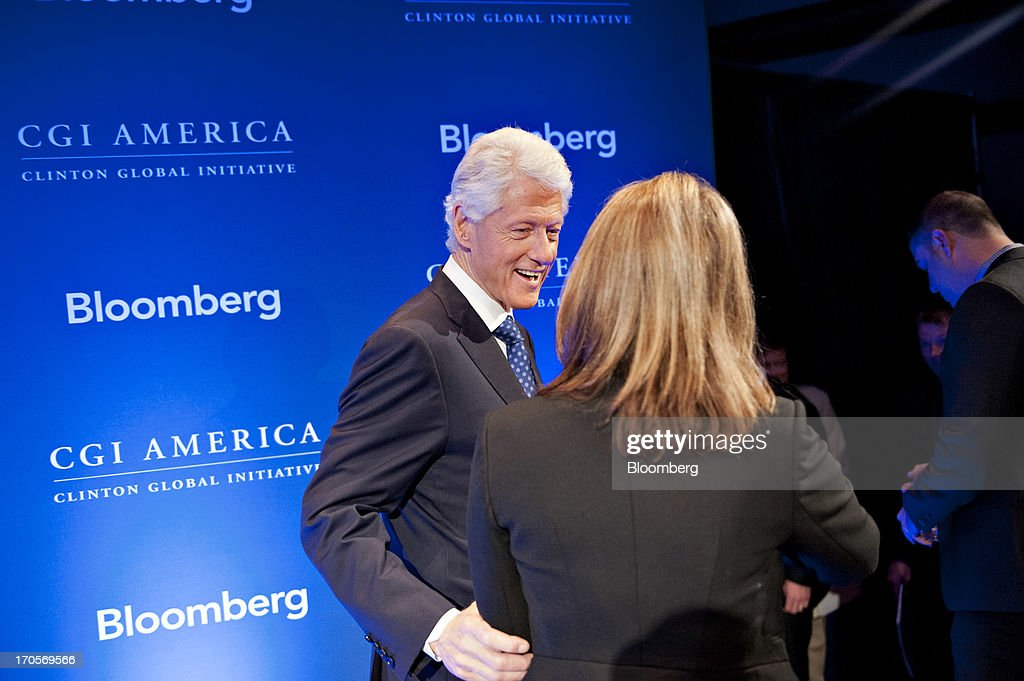 Former U.S. President <a gi-track='captionPersonalityLinkClicked' href=/galleries/search?phrase=Bill+Clinton&family=editorial&specificpeople=67203 ng-click='$event.stopPropagation()'>Bill Clinton</a> speaks to an attendee as he leaves the stage following an interview at the Clinton Global Initiative CGI America meeting in Chicago, Illinois, U.S., on Friday, June 14, 2013. New Jersey governor Chris Christie and Democrat Hillary Clinton, both potential presidential candidates will be able to use the forum to test policy messages in front of an audience of U.S. mayors and other civic and business leaders. Photographer: Daniel Acker/Bloomberg via Getty Images
