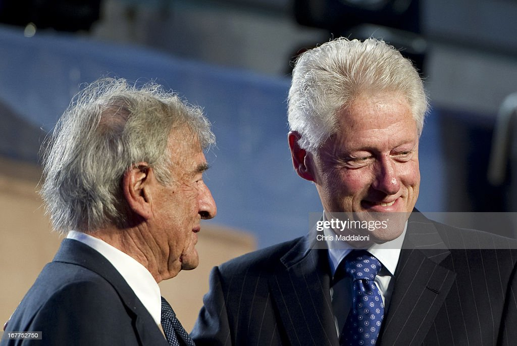 Former US President Bill Clinton speaks with Elie Wiesel, founding chairman of the Holocaust Memorial Museum, at a ceremony for the museum's 20th anniversary in Washington, DC.