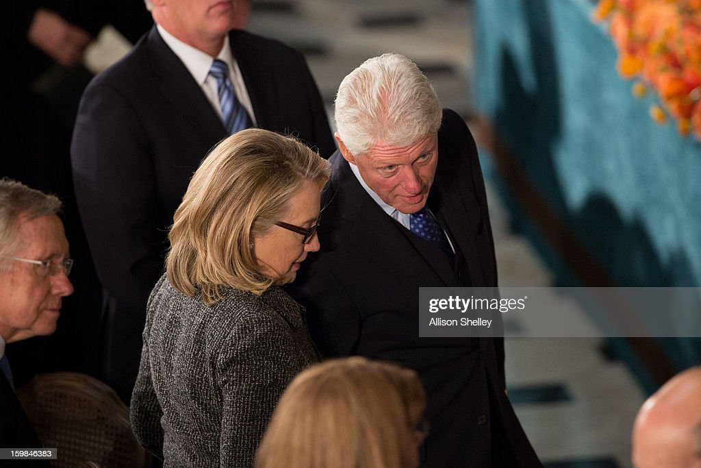 Former U.S. President <a gi-track='captionPersonalityLinkClicked' href=/galleries/search?phrase=Bill+Clinton&family=editorial&specificpeople=67203 ng-click='$event.stopPropagation()'>Bill Clinton</a> speaks with his wife Secretary of State <a gi-track='captionPersonalityLinkClicked' href=/galleries/search?phrase=Hillary+Clinton&family=editorial&specificpeople=76480 ng-click='$event.stopPropagation()'>Hillary Clinton</a> during the Inaugural Luncheon in Statuary Hall on Inauguration day at the U.S. Capitol building January 21, 2013 in Washington D.C. U.S. President Barack Obama, will be ceremonially sworn in for his second term today.
