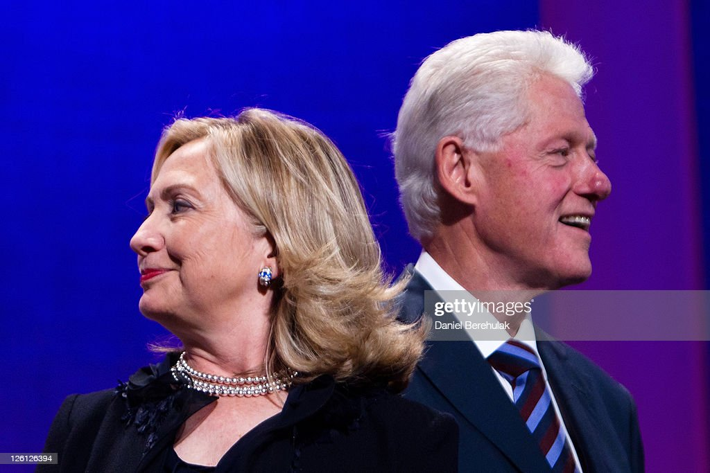 Former US President <a gi-track='captionPersonalityLinkClicked' href=/galleries/search?phrase=Bill+Clinton&family=editorial&specificpeople=67203 ng-click='$event.stopPropagation()'>Bill Clinton</a> (R) stands on stage with his wife Hillary Rodham Clinton, Secretary of State during the closing Plenary session of the seventh Annual Meeting of the Clinton Global Initiative (CGI) at the Sheraton New York Hotel on September 22, 2011 in New York City. Established in 2005 by former U.S. President <a gi-track='captionPersonalityLinkClicked' href=/galleries/search?phrase=Bill+Clinton&family=editorial&specificpeople=67203 ng-click='$event.stopPropagation()'>Bill Clinton</a>, the CGI assembles global leaders to develop and implement solutions to some of the world's most urgent problems.