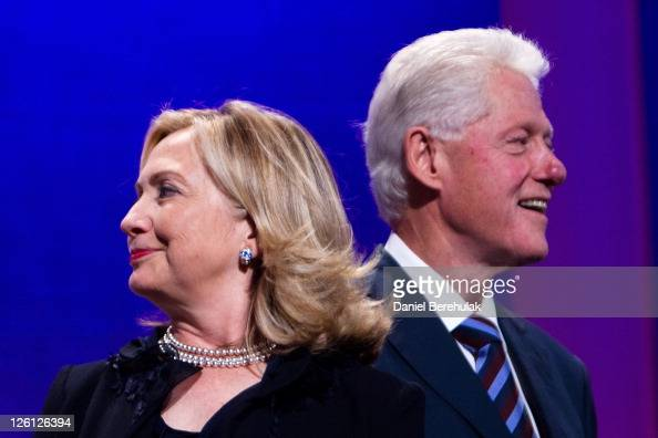 Former US President Bill Clinton stands on stage with his wife Hillary Rodham Clinton Secretary of State during the closing Plenary session of the...