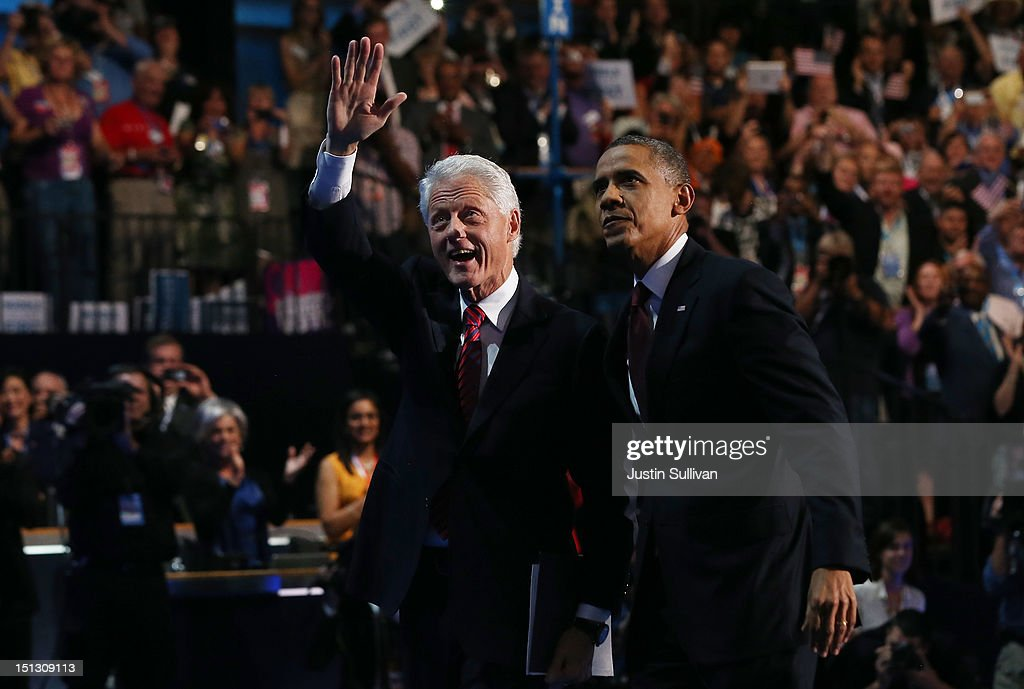 Former U.S. President <a gi-track='captionPersonalityLinkClicked' href=/galleries/search?phrase=Bill+Clinton&family=editorial&specificpeople=67203 ng-click='$event.stopPropagation()'>Bill Clinton</a> stands with Democratic presidential candidate, U.S. President <a gi-track='captionPersonalityLinkClicked' href=/galleries/search?phrase=Barack+Obama&family=editorial&specificpeople=203260 ng-click='$event.stopPropagation()'>Barack Obama</a> (R) on stage during day two of the Democratic National Convention at Time Warner Cable Arena on September 5, 2012 in Charlotte, North Carolina. The DNC that will run through September 7, will nominate U.S. President <a gi-track='captionPersonalityLinkClicked' href=/galleries/search?phrase=Barack+Obama&family=editorial&specificpeople=203260 ng-click='$event.stopPropagation()'>Barack Obama</a> as the Democratic presidential candidate.