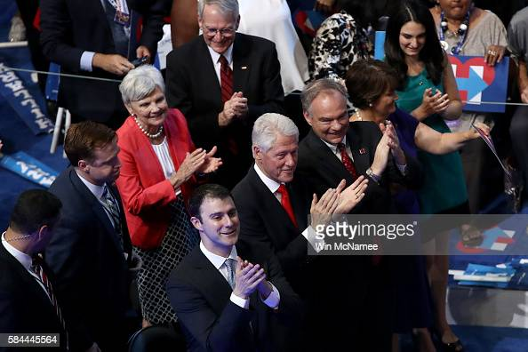Former US President Bill Clinton stands with US Vice President nominee Tim Kaine along with his wife Anne Holton and Marc Mezvinsky as Chelsea...
