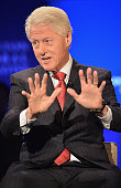 Former US President Bill Clinton takes part in the 'CGI Conversation Hosted by PBS's Charlie Rose' for the Clinton Global Initiative on September 22...
