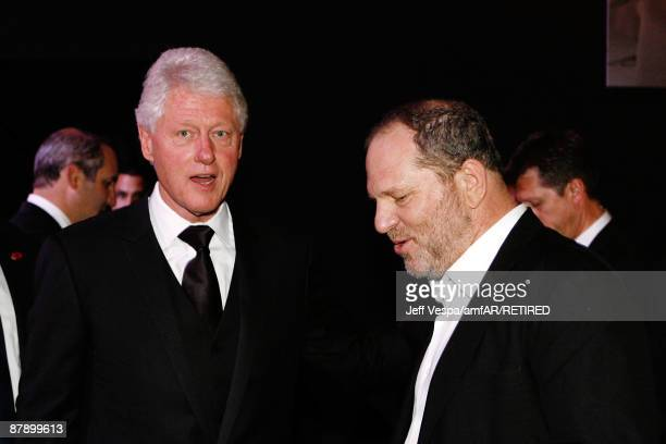 Former US President Bill Clinton talks to Harvey Weinstein during the amfAR Cinema Against AIDS 2009 benefit at the Hotel du Cap during the 62nd...