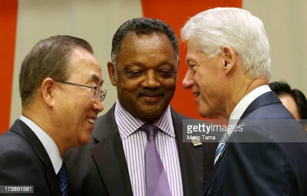 Former US President Bill Clinton United Nations SecretaryGeneral Ban Kimoon and Rev Jesse Jackson speak before the start of an informal meeting of...