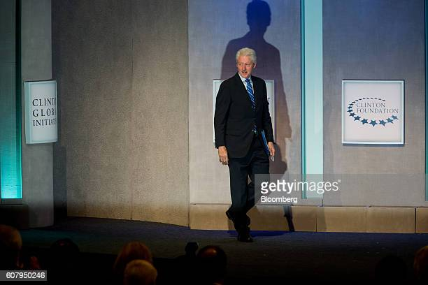 Former US President Bill Clinton walks on stage to speak during the annual meeting of the Clinton Global Initiative in New York US on Monday Sept 19...