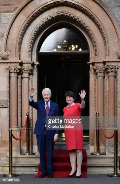 Former US President Bill Clinton waves alongside DUP leader Arlene Foster at the Culloden Hotel following a private meeting on October 17 2017 in...
