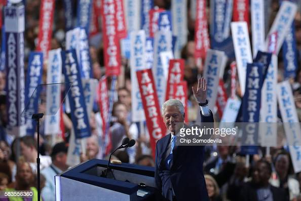 Former US President Bill Clinton waves to the crowd as he arrives on stage to deliver remarks on the second day of the Democratic National Convention...