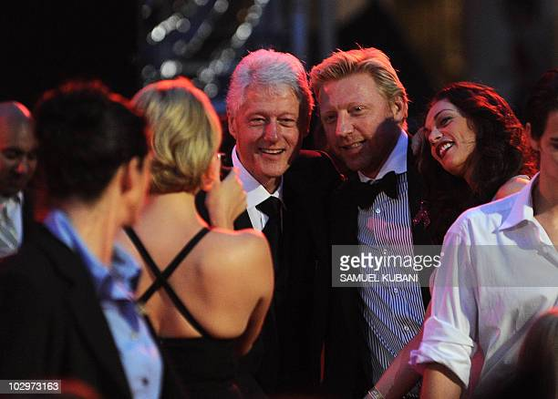 Former US President Bill Clinton with Germany tennis player Boris Becker pose for photography during the 18th Life Ball in Vienna late on July 17...