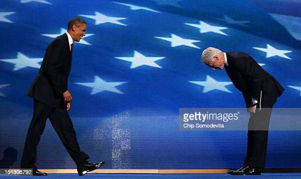 Former US President Bill Clintongreets Democratic presidential candidate US President Barack Obama on stage during day two of the Democratic National...