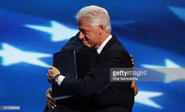 Former US President Bill Clintonhugs Democratic presidential candidate US President Barack Obama on stage during day two of the Democratic National...
