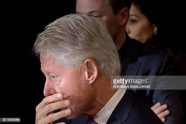 Former US President Clinton waits for his wife former Democratic US Presidential candidate Hillary Clinton after she spoke to the press at the New...