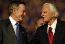 Former US President George Bush and the Rev Billy Graham talk during the first of a fourday revival meeting October 17 2002 at Texas Stadium in...