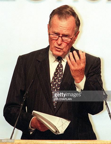 Former US President George Bush reads from a letter he wrote to late Chinese leader Deng Xiaoping after the massacre Beijing's Tiannanmen Square in...