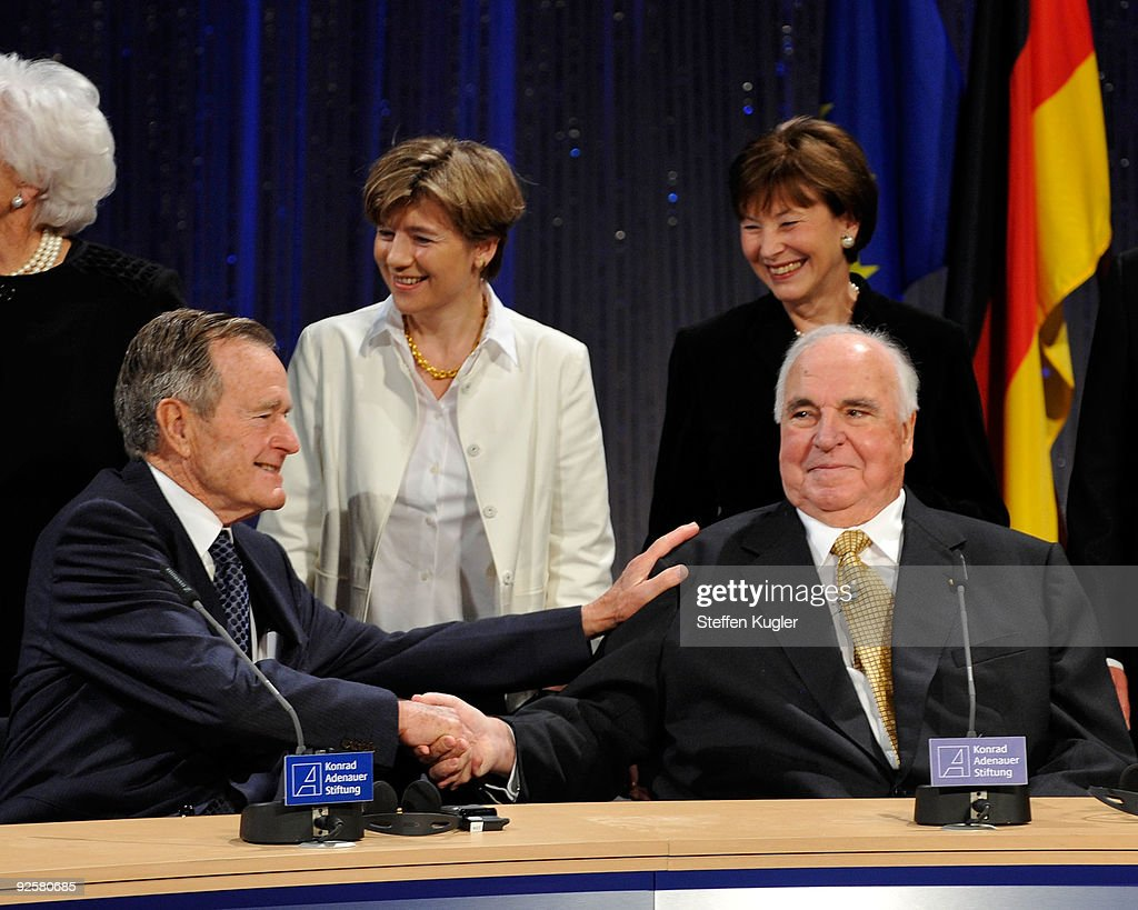 Former US president George H W Bush greats former German Chancellor Helmut Kohl as Kohls wife Maike RichterKohl and the wife of German President...