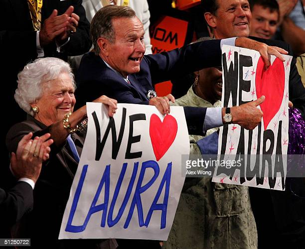 Former US President George HW Bush and his wife Barbara cheer as their daughterinlaw US First lady Laura Bush takes the stage on night two of the...