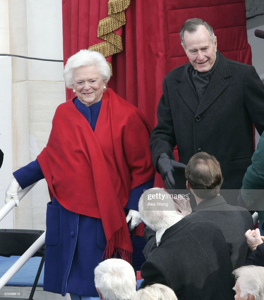 Former U.S. President George H.W. Bush (R) and wife, Barbara Bush (L), arrive on the inaugural platform before the start of the swearing in ceremony for their son U.S. President George W. Bush January 20, 2005 in Washington, DC. President George W. Bush will take his second oath of office January 20.