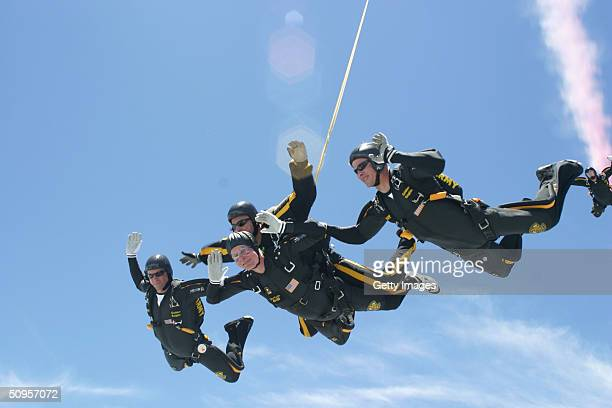 Former US President George HW Bush performs a tandem parachute jump with Army Golden Knight Sgt Bryan Schnell on June 13 2004 over the Bush...