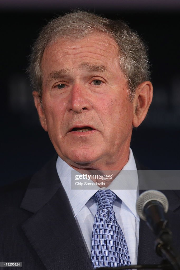 Former US President George W Bush addresses a summit on 'creating employment opportunities for post9/11 veterans and military families' at the US...