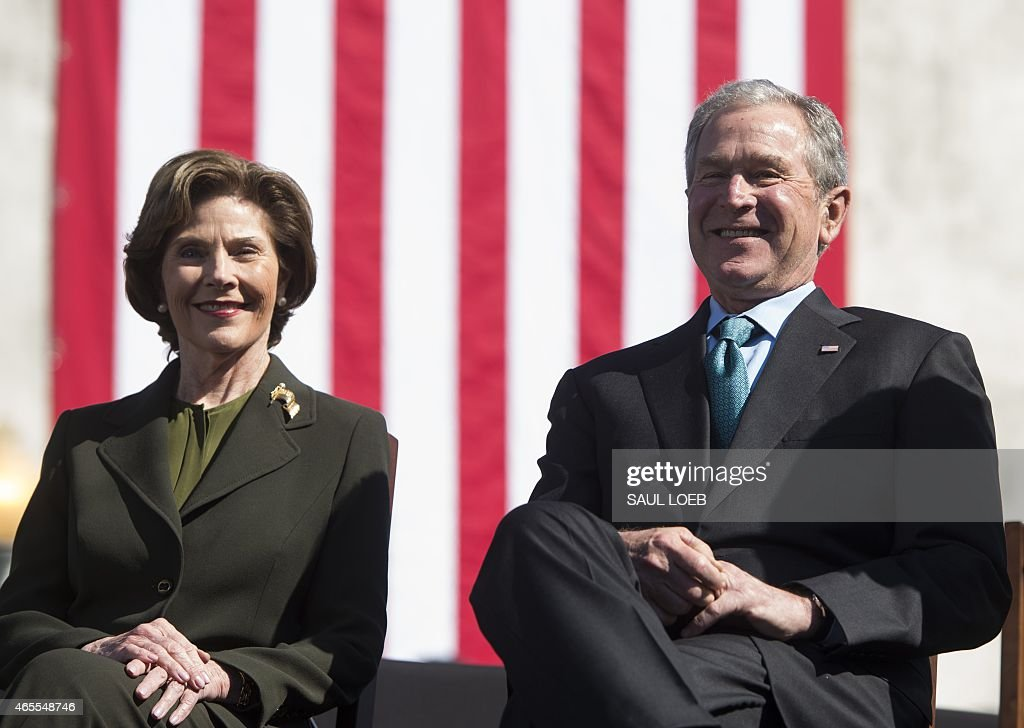 Former US President George W Bush and First Lady Laura Bush attend an event marking the 50th Anniversary of the Selma to Montgomery civil rights...