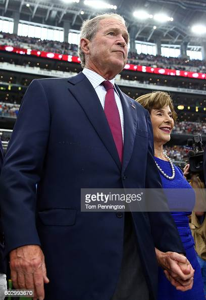 Former US President George W Bush and Laura Bush attend the game between the Dallas Cowboys and New York Giants at ATT Stadium on September 11 2016...