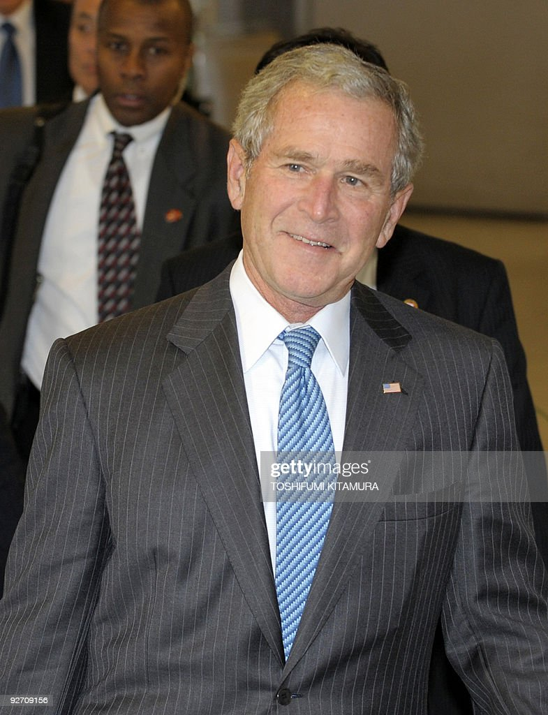 Former US president <a gi-track='captionPersonalityLinkClicked' href=/galleries/search?phrase=George+W.+Bush&family=editorial&specificpeople=122011 ng-click='$event.stopPropagation()'>George W. Bush</a> arrives at the Narita International airport, near Tokyo, on November 3, 2009. Bush arrived in Japan on a private call after paying a visit to Singapore.
