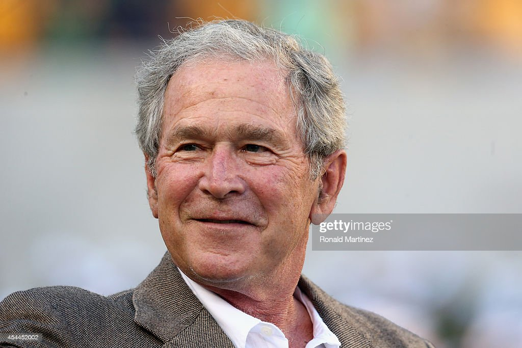 Former US President George W Bush attends a game between the Southern Methodist Mustangs and the Baylor Bears at McLane Stadium on August 31 2014 in...