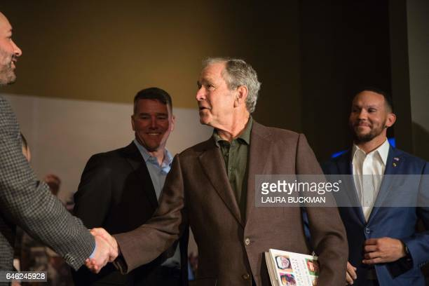 Former US President George W Bush greets US military veterans at a press preview of his new painting exhibit 'Portraits of Courage' at the George W...
