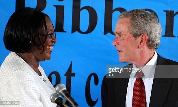Former US President George W Bush is greeted Zambia's First Lady Christine Kaseba Sata shortly after launching the Pink Ribbon and Red Ribbon global...
