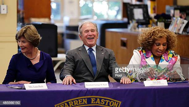 Former US President George W Bush laughs with Doris Hicks CEO/Principal of Dr Martin Luther King Jr Charter School of Science and Technology and...