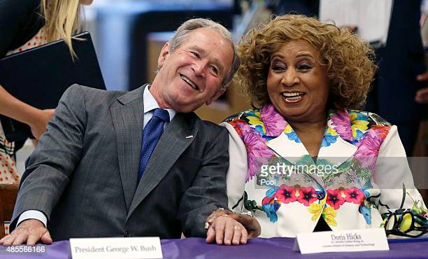Former US President George W Bush laughs with Doris Hicks CEO/Principal of Dr Martin Luther King Jr Charter School of Science and Technology during a...