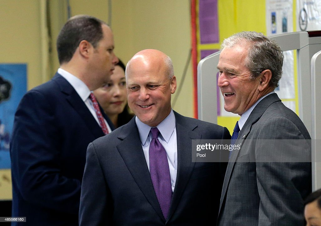 Former U.S. President <a gi-track='captionPersonalityLinkClicked' href=/galleries/search?phrase=George+W.+Bush&family=editorial&specificpeople=122011 ng-click='$event.stopPropagation()'>George W. Bush</a> (R) laughs with New Orleans Mayor <a gi-track='captionPersonalityLinkClicked' href=/galleries/search?phrase=Mitch+Landrieu&family=editorial&specificpeople=626024 ng-click='$event.stopPropagation()'>Mitch Landrieu</a> as they enter a roundtable discussion on education at Warren Easton Charter High School on August 28, 2015 in New Orleans, Louisiana. The former President's visit came as the town prepares to honor the tenth anniversary of Hurricane Katrina on August 29. Hurricane Katrina killed 1836 people and is considered the costliest natural disaster in U.S. history.
