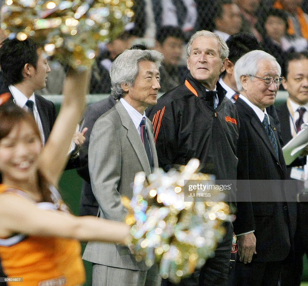 Former US president George W Bush smiles with former Japanese prime minister Junichiro Koizumi before taking part in the ceremonial first pitch for...