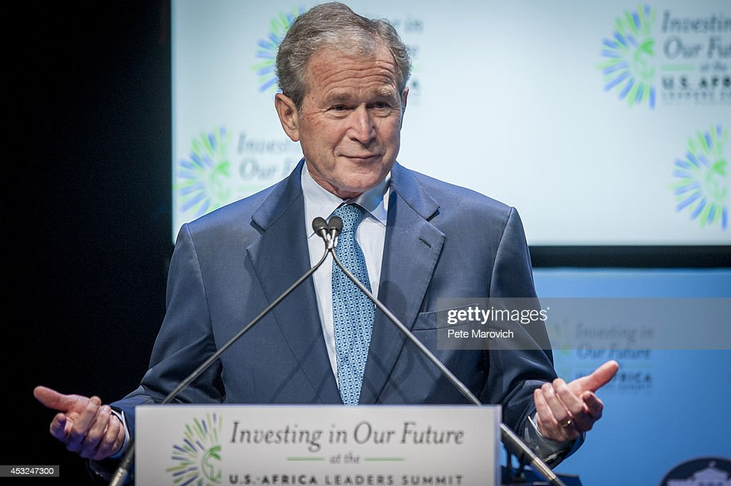 Former U.S. President <a gi-track='captionPersonalityLinkClicked' href=/galleries/search?phrase=George+W.+Bush&family=editorial&specificpeople=122011 ng-click='$event.stopPropagation()'>George W. Bush</a> speaks at a Spousal Symposium at the John F. Kennedy Center for the Performing Arts on August 6, 2014 in Washington, DC. The symposium, sponsored by first lady Michelle Obama and former first lady Laura Bush, focuses on the role the spouses of world leader's play and the impact of investments in education, health, and economic development through public-private partnerships.