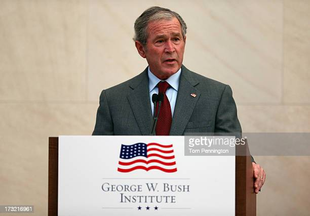 Former US President George W Bush speaks during a immigration naturalization ceremony held at the George W Bush Presidential Center on July 10 2013...