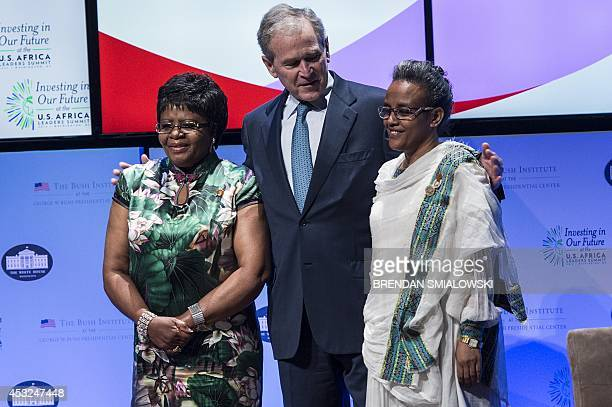 Former US President George W Bush stands with Penehupifo Pohamba first lady of Namibia and Roman Tesfaye first lady of Ethiopia after announcing...