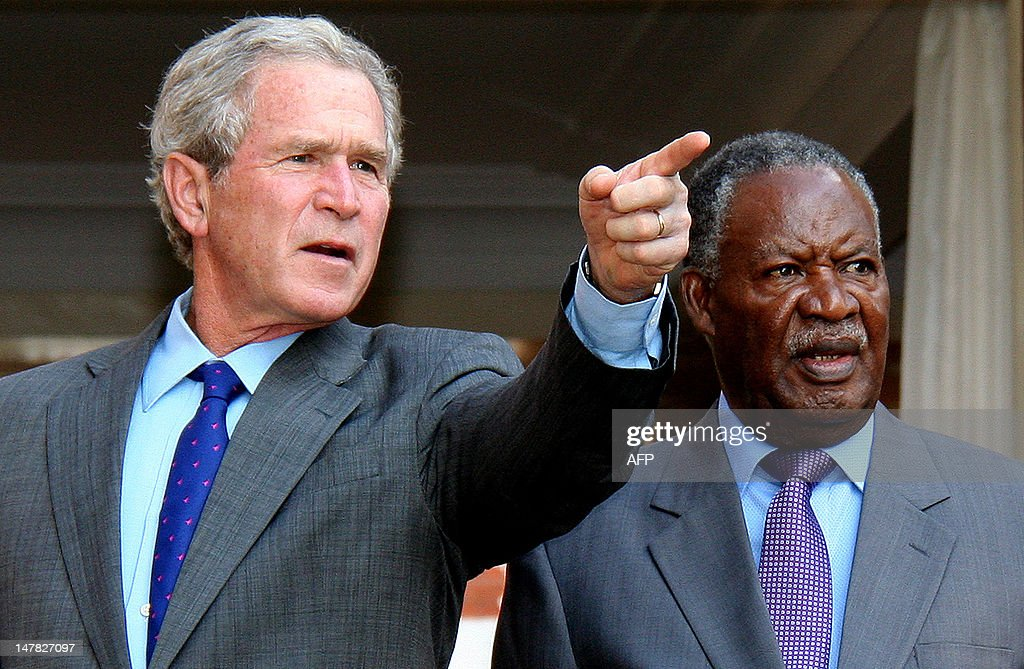 Former US President George W. Bush (R) talks to Zambian President <a gi-track='captionPersonalityLinkClicked' href=/galleries/search?phrase=Michael+Sata&family=editorial&specificpeople=1944545 ng-click='$event.stopPropagation()'>Michael Sata</a> on July 4, 2012 at the State house, in Lusaka. Bush is in Zambia as part of a cervical and breast cancer awareness campaign.