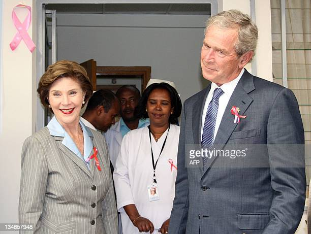 Former US President George W Bush with his wife former firstlady Barbara visit a US funded hospital treating people with HIV/AIDS in Addis Ababa on...